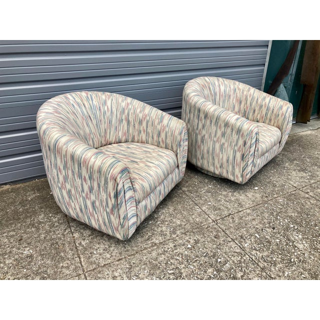 This pair of chairs has that perfect Miami Vice looking upholstery that would look phenomenal in any contemporary home....