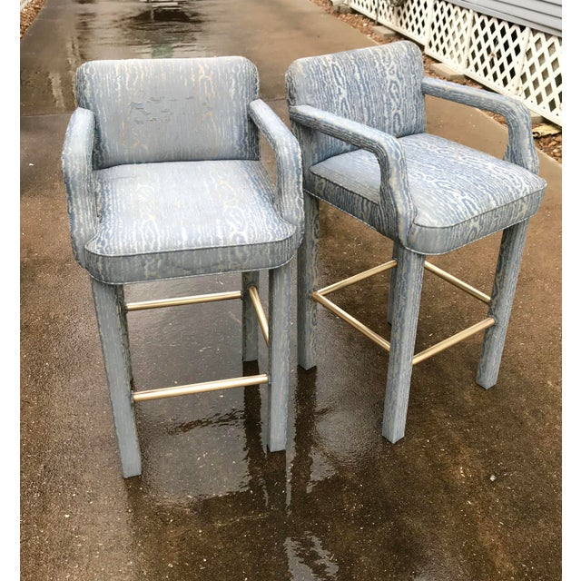 Vintage pair of Hollywood Regency-Style parsons barstools with solid brass foot bars. Structurally, both stools are in...
