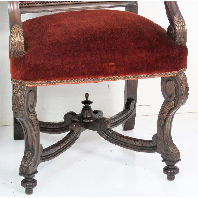 Carved frames. Gilt highlights. Red velvet upholstery. Tears in upholstery. Wear.