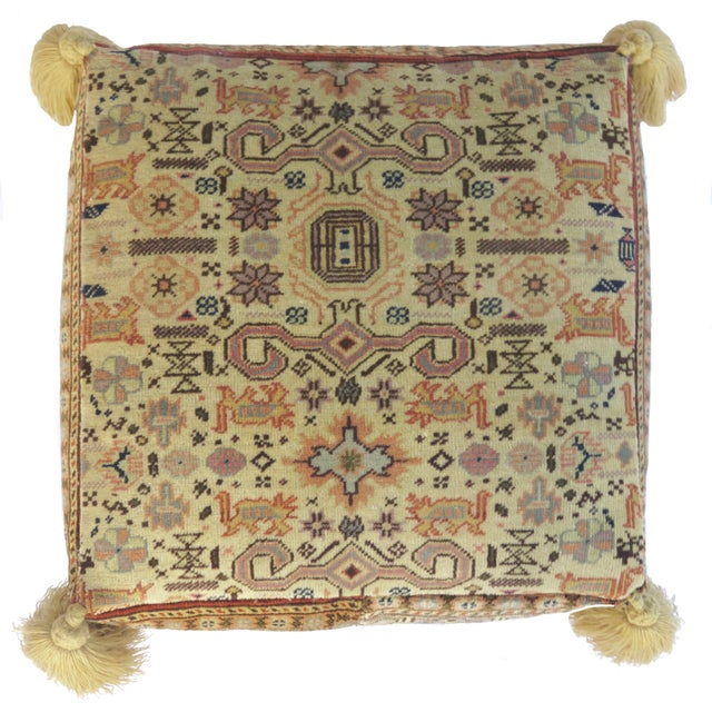 Floor pouf made from an abstract vintage Turkish rug handwoven with honey, lavender, coral and brown colored hand spun...
