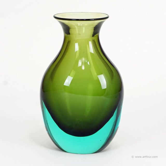a nice murano glass vase manufactured by vetreria gino cenedese and designed by antonio da ros in the 1960ties. green and...