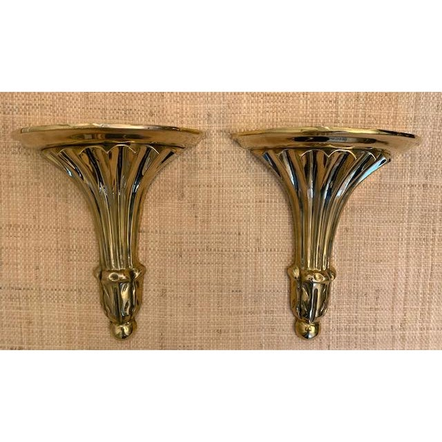 Heavy brass pair of fluted wall shelves/brackets. Lovely lacquered brass.