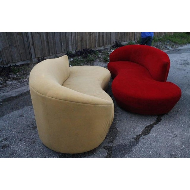 Great vintage Hollywood Regency pair of cloud sofas. Free form curved, original ultrasuede fabric with chrome feet. When...