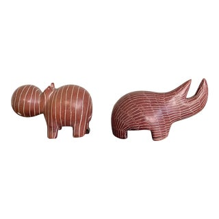 Hand Carved Red Soapstone Rhino and Hippopotamus Figurines - Pair For Sale