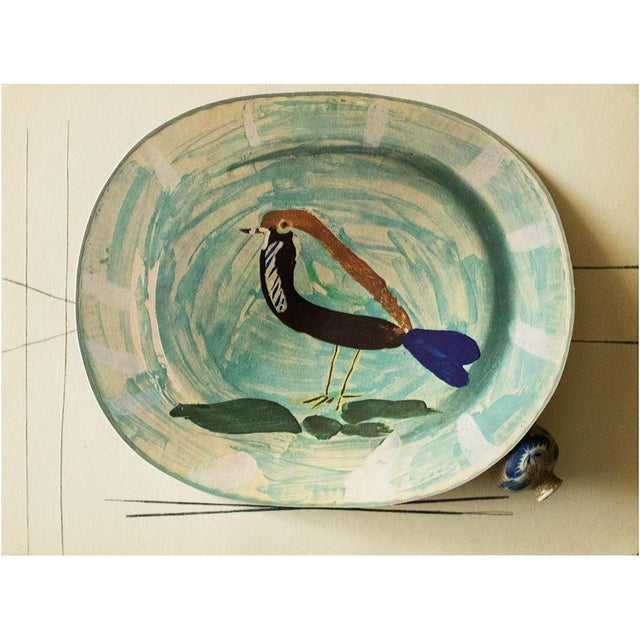 A rare exquisite original period offset lithograph of ceramic plate or charger depicting a Polychrome Bird by Pablo...