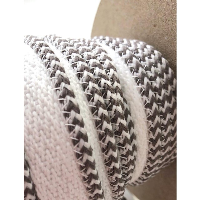 """One, 11 yard spool of 1/8"""" (3mm) braided cord with flange. Total height of item: 5/8"""" This Indoor/Outdoor cording is..."""