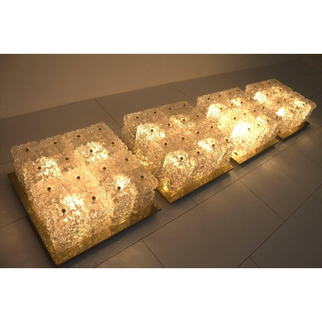 Set of four flush mount chandeliers by Glashütte Limburg in Brass and Glass , 1960s. Very good original condition. The...