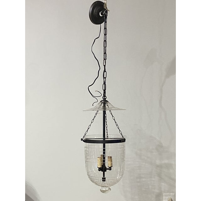 Lovely vintage hand blown bell jar lantern with etched classic Greek key design and bronze fittings. Fixture is...