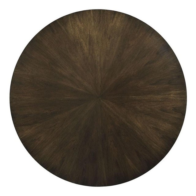 A stately center table with a solid pedestal base and a rich hue finished in our Mink finish. This table is well...