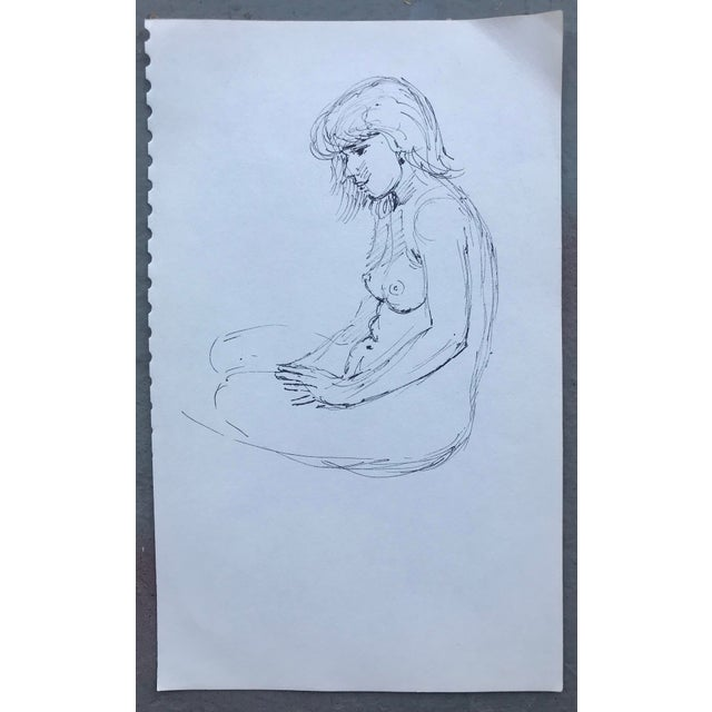 Seated female nude removed from a sketchbook.