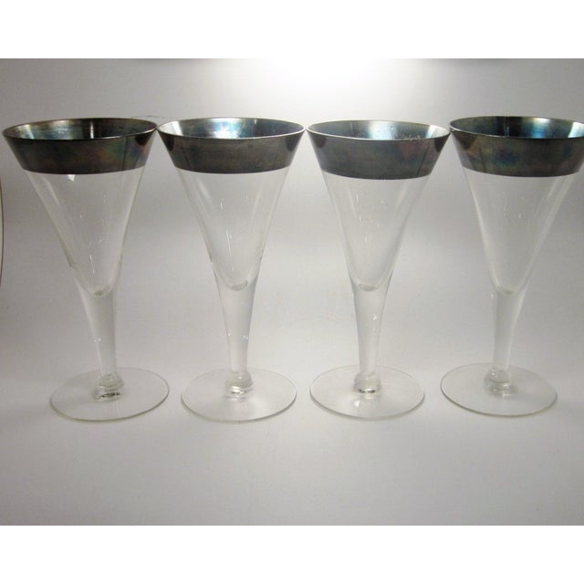 This is a jaw-dropping set of 8 vintage Mid Century Modern era sterling silver rimmed stemware. These glasses are slender...