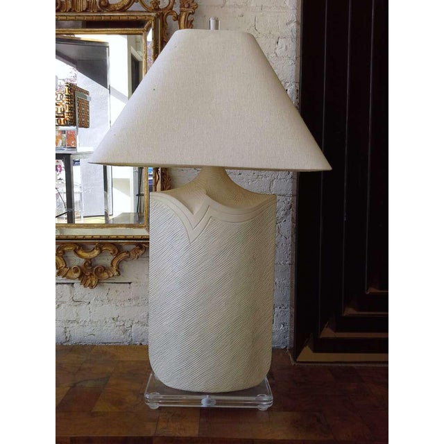 A slim profile plaster and Lucite table lamp by casual lamps. Great slim elegant profile.