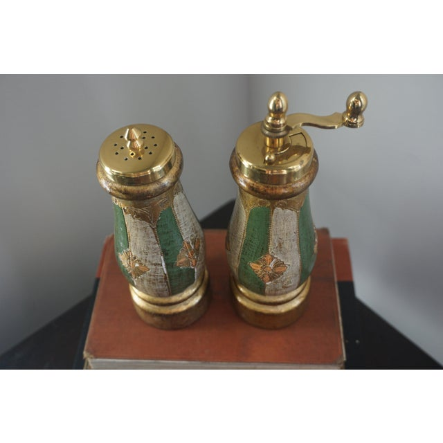 How cool are these? Functional, too. Italian gilt painted wood salt and pepper set. Carved and painted by hand. Use for a...