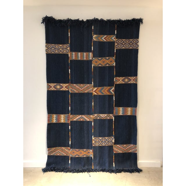 Vintage wool Jordanian rug. Striking deep blue color with accents of saffron yellow, rust, cream and light blue. Circa...