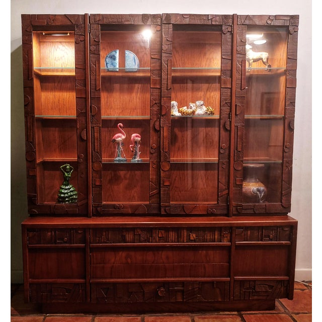 In the style of Let Corbusier, this Lane Brutalist cabinet with interior lighted and glass shelves is a stunned by piece....