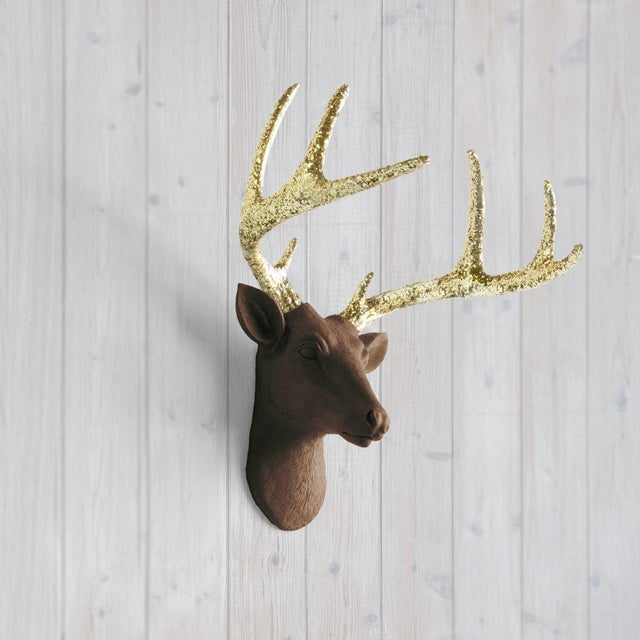 The MINI Virginia Chocolate Brown + Gold Glitter Antlers faux taxidermy Deer Head Wall Sculpture. This wall mount features...