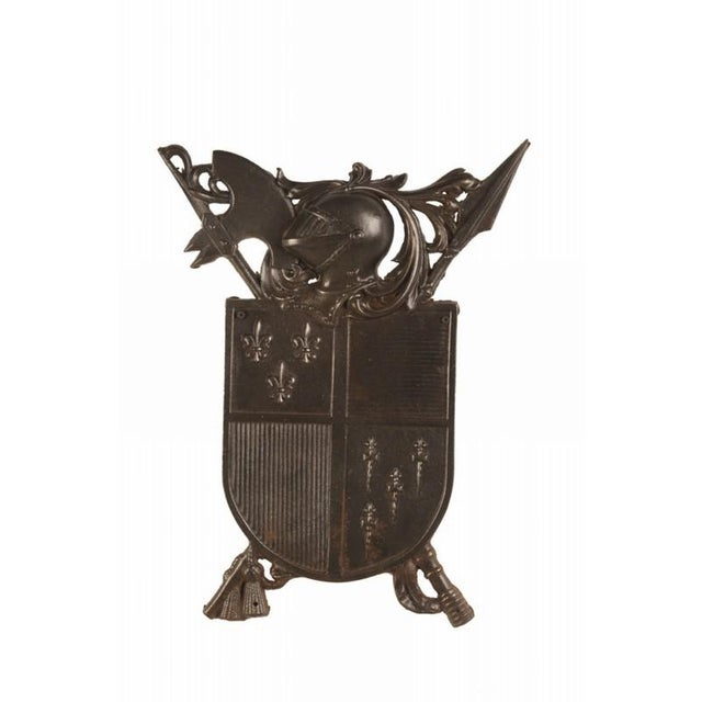 A solid cast iron plaque from France c. 1885 featuring an homage to the age of chivalry and bravery in battle. Please...
