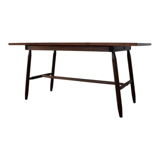 Misterioso Dining Table in Walnut with Hand Shaped Base For Sale