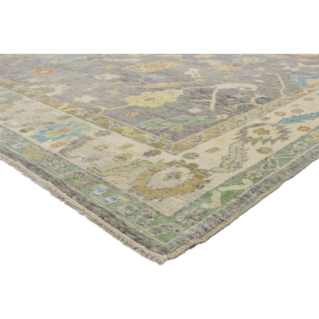 52537 Contemporary Turkish Oushak Rug with Pastel Colors and French Transitional Style 09'09 x 13'07. Highly stylish yet...