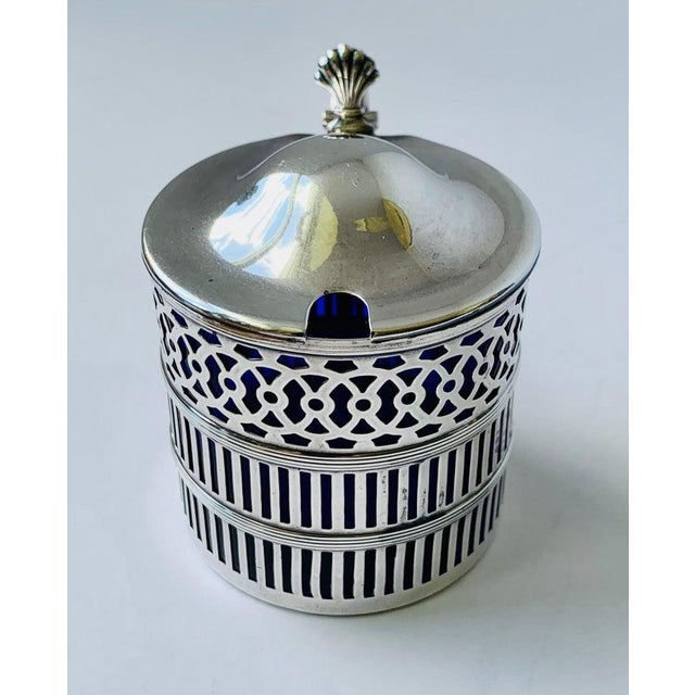 This handsome sterling silver mustard pot is by Webster Company. They were founded in 1894 in North Attleboro,...