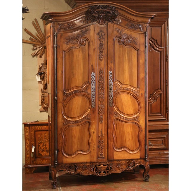 """This antique fruitwood """"armoire provencale,"""" is truly exceptional. Crafted in France, circa 1760, this tall cabinet..."""
