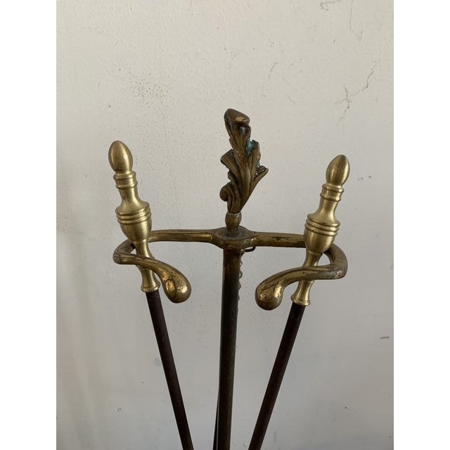 Stunning set of antique late 19th century English brass and metal mounted fireplace tools including shovel, tongs and...