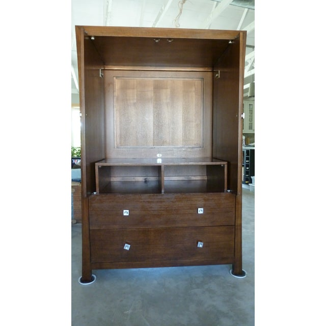 This gorgeous armoire/media cabinet provides a lot of storage in a modern package. It is approximately 10 years old and in...