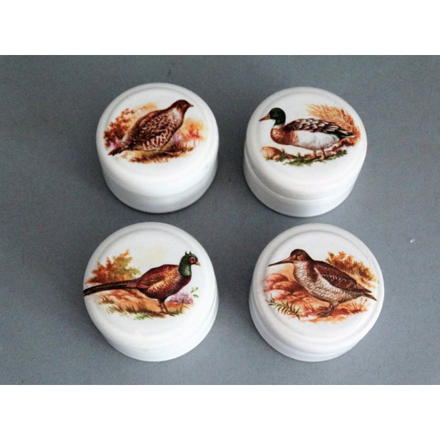 A set of 4 collectible English ceramic jars or boxes, each with a different game bird on the top. These jars previously...