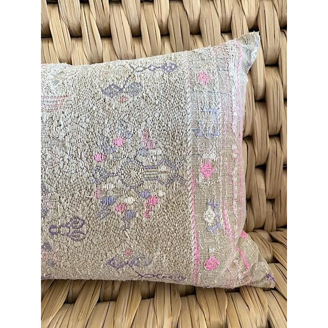 Throw pillow made from beautiful vintage Chinese Minority Tribe wedding blanket in soft pinks and purples. Pillow back is...