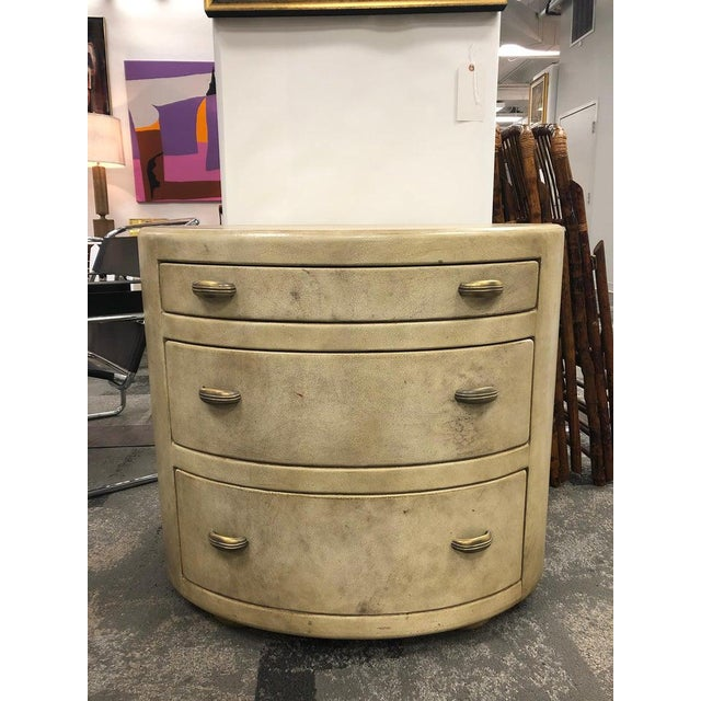 Mid-century Italian oval leather dresser with brass hardware.