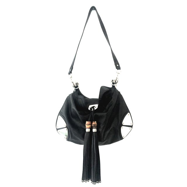 """21st Century Gucci Black Leather & Chrome """"Indy"""" Hobo Hand Bag. Crafted from the finest Italian leather, features faux..."""