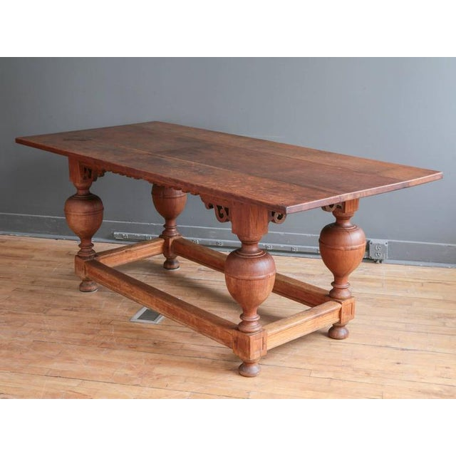 A substantial oak Jacobean style refectory table, circa 19th century. Featuring large turned baluster legs and twin...