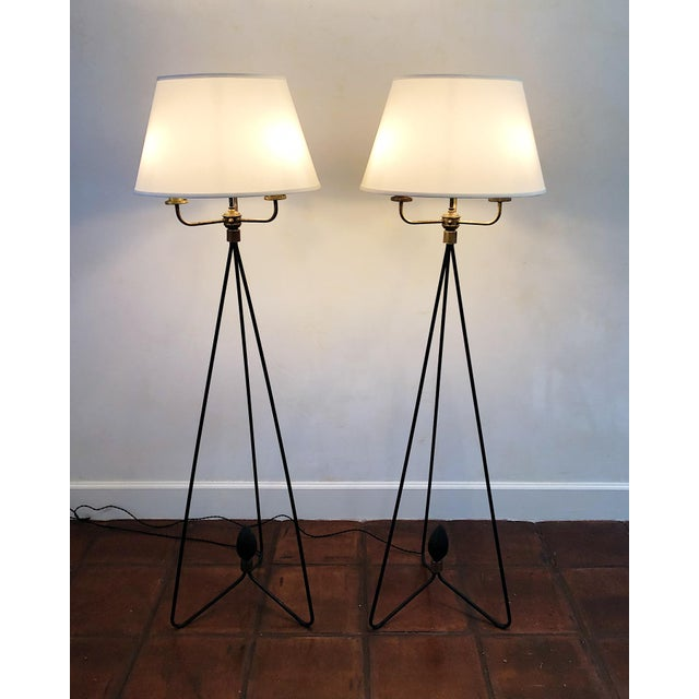These pair of elegant, mid-century floor lamps take on the traditional candelabra that's reminiscent of French or Spanish...