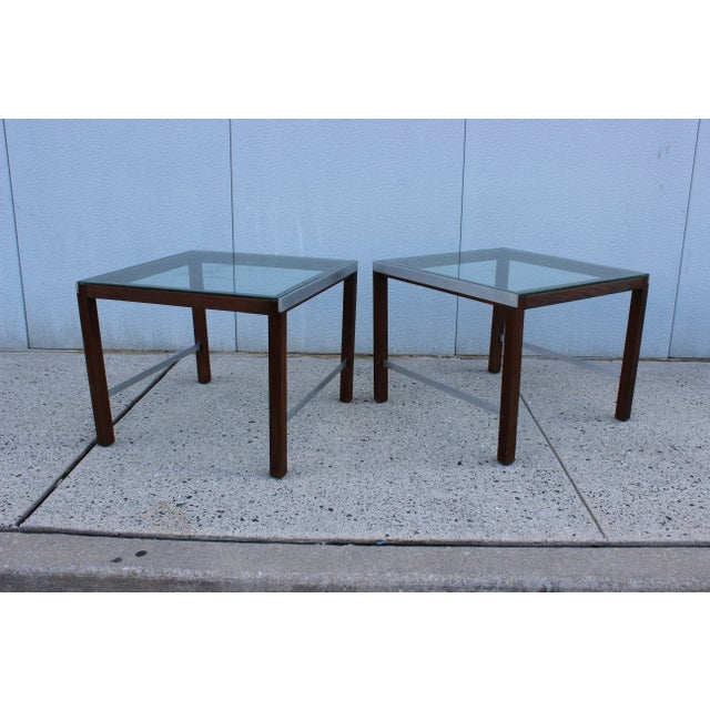 This fabulous pair of large 1970's modern chrome and walnut side tables with glass tops will feel right at home with an...