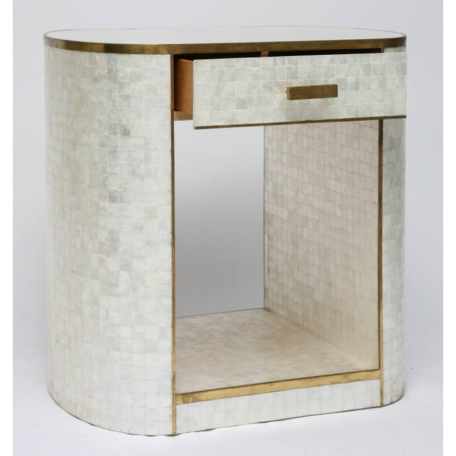 This beautify and stylish piece was created by the Platt Collections and is fabricated in capiz shell with antique-...