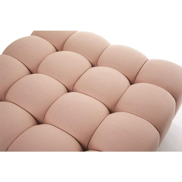 Bubbly and delicious, this hand-tufted ottoman beautifully shapes any space. The delicate crown of each tuft is fun and...