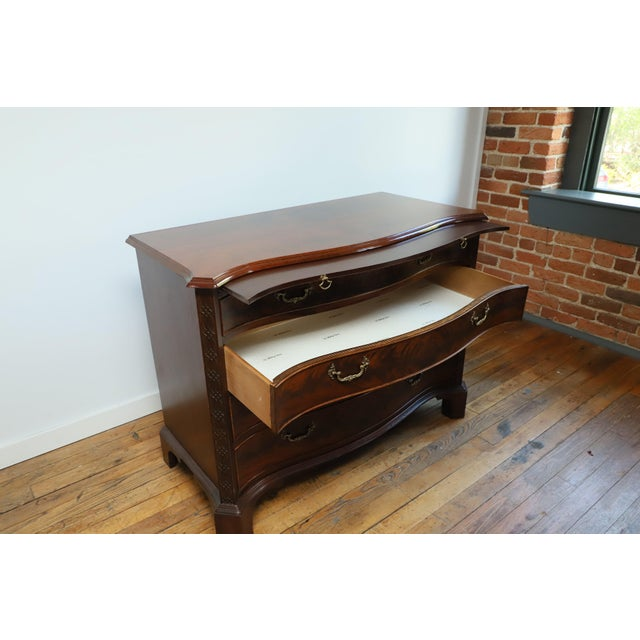 Vintage John Stuart, Inc. (ran from 1934-1956) Chippendale Style Flame Mahogany Chest Chippendale-style flame mahogany...
