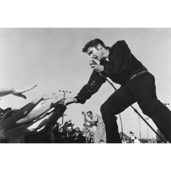 """Elvis Presley aka """"King of Rock and Roll"""" is photographed performing at the Mississippi-Alabama Fair and Dairy Show in..."""