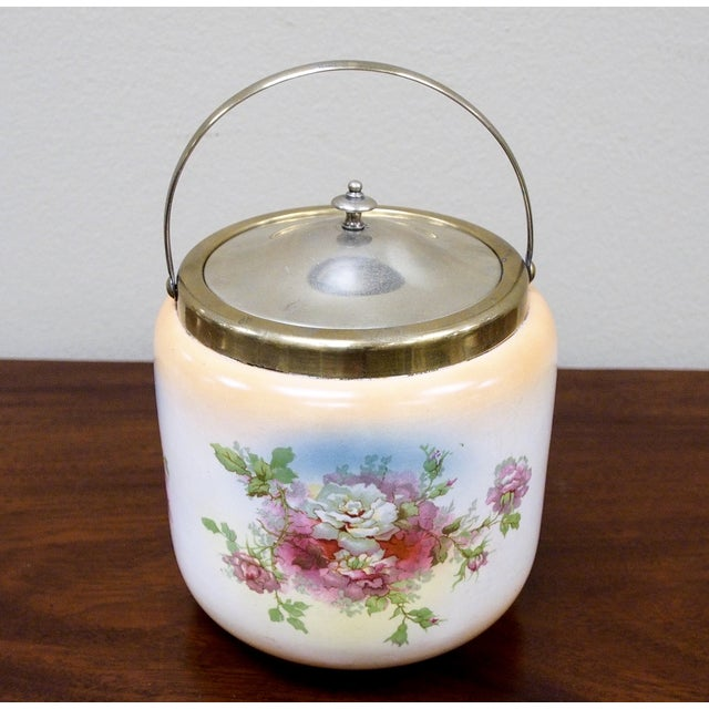 Crown Devon S. Fielding & Co., blush ivory floral ceramic biscuit barrel / ice bucket with brass mounts, handle and lid....