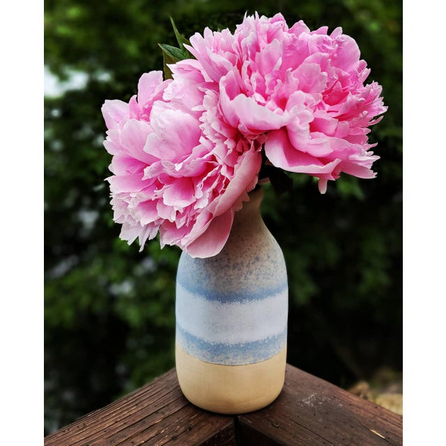 This Beach Sand Inspired Decorative Vase is handmade in Thailand evoking a zen-like a vibe. A mix of the colors sand,...