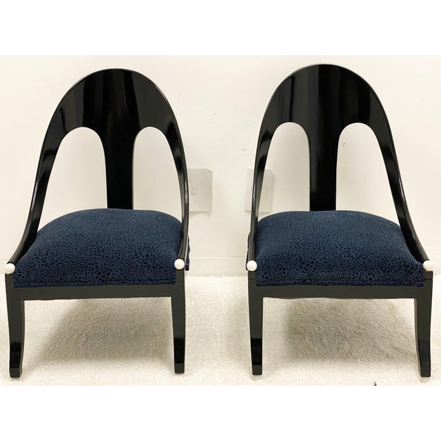 This is a pair of mid-century black lacquer modern spoon or horseshoe back chairs with new blue velvet leopard upholstery....