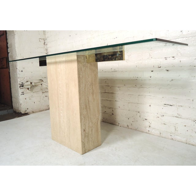 Modern travertine marble base with long glass top console table. (Please confirm item location - NY or NJ - with dealer)....