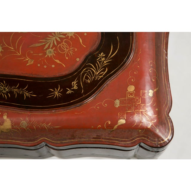 A rare large 19th century Chinese export Papier mâché lacquered cinnabar and black scalloped robe box on a later steel and...