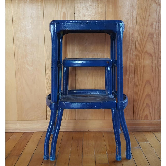 Chippy blue paint, vintage step stool, strong and sturdy metal, great in a kitchen or used as a plant stand.