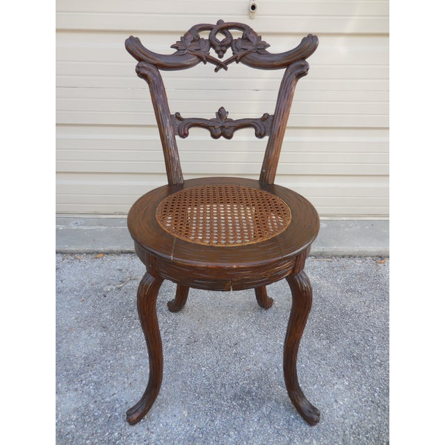 Unique Blackforest Childs Chair with cane seat. In excellent condition. Circa 1890-1910.