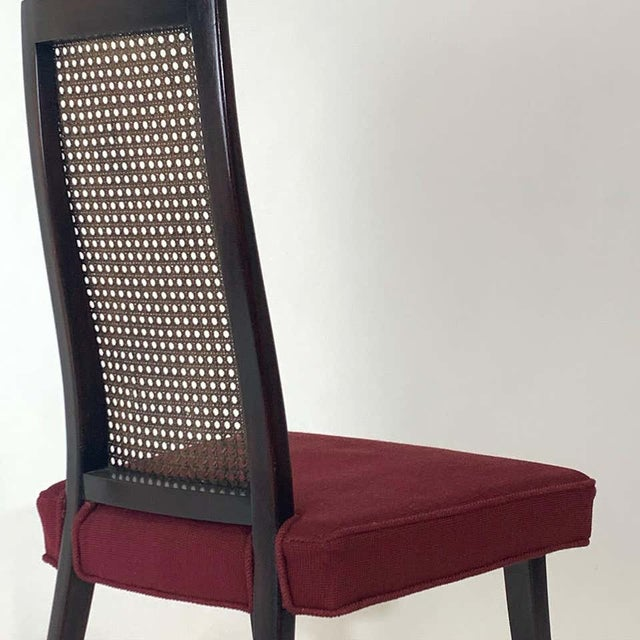 A very elegant set of four sculptural saber legged Harvey Probber model 1055 cane and ebonized mahogany dining chairs.