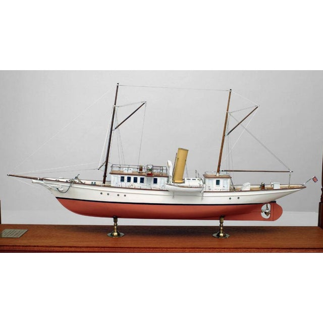 "Pink and white schooner ship model encased in a rectangular, mahogany display case with carved spindle sides. Marked ""Lady..."