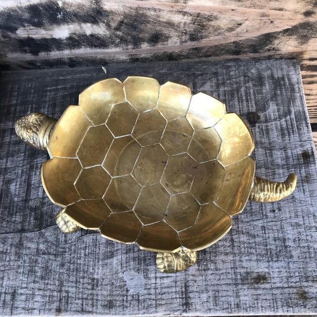 Large vintage brass turtle trinket dish or catchall. Great detail on legs, head and tail, Scalloped edge around the...