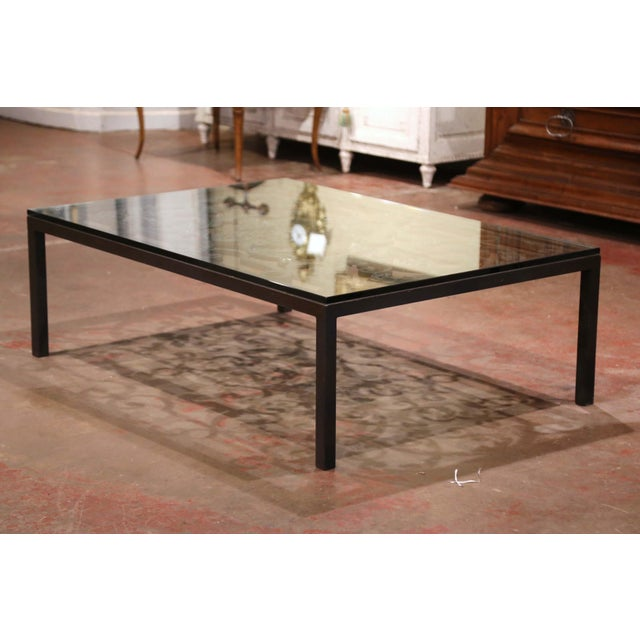 This large coffee table base was crafted using an ornate antique gate from France. The elegant table stands on four square...