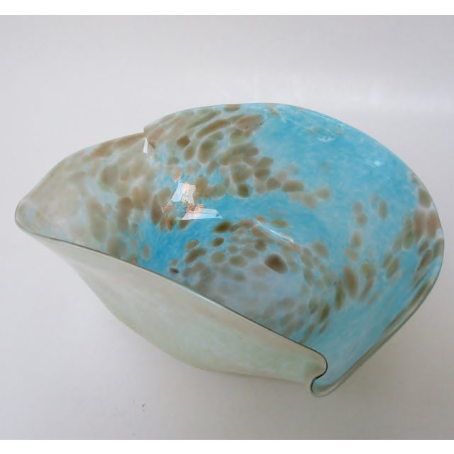 Murano blown glass console bowl in a biomorphic shape, finished in powder blue with copper aventurine inclusions and a...
